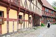 Costume character and half-timbered building at Den Gamle By, The Old Town, folk museum at Aarhus, Denmark