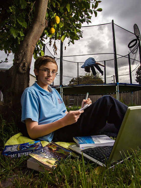 Boys doing home work & playing on back yard trampoline melbourne photographers, commercial photographers, industrial photographers, corporate photographer, architectural photographers, This photograph can be used for non commercial uses with attribution. Credit: Craig Sillitoe Photography / http://www.csillitoe.com<br /> <br /> It is protected under the Creative Commons Attribution-NonCommercial-ShareAlike 4.0 International License. To view a copy of this license, visit http://creativecommons.org/licenses/by-nc-sa/4.0/.