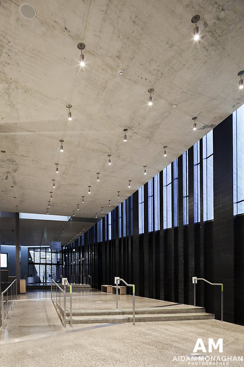 Building Name: GIANT'S CAUSEWAY VISITOR CENTRE<br /> Building Type: NATURAL WORLD - VISITOR CENTRE<br /> Architect: HENEGHAN PENG<br /> Architect Website: http://www.hparc.com<br /> Clients Website http://www.nationaltrust.org.uk<br /> Town:BUSHMILLS<br /> Year of Completion: 2012<br /> County:ANTRIM<br /> Collection: Architecture Photography <br /> Country: United Kingdom<br /> The Giant's Causeway lies in Northern Ireland's Causeway Coast World Heritage Site, a landscape of cliffs formed by hexagonal basalt stones, agricultural landscapes and cliffside walks. Utilising the large difference in level across the site, two folds are created in the landscape. One, extending the line of the ridge, accommodates the building. The second, extending the level of the road, screens the car park from view. There is no longer a building and landscape but building becomes landscape and the landscape itself remains spectacular and iconic.<br /> Irish, Information Centres, Landmark, Antrim, Exterior Landscape, Architectural,Visitor Centre, Architecture photography, Architectural photography, Visitor Information Centre Britain, N Ireland, Structure, Giant's Causeway Visitor Centre, Tourist Information, Visitor Information Centre, British Isles, Bushmills, Northern Ireland, Tourist Information Centre, Cliff, Heneghan Peng Architects, World Heritage Site, Hexagonal Basalt Stone.