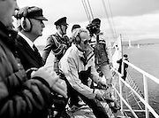 President Patrick Hillery watches the yachts depart after firing the starting cannon to start the Round Europe Yacht Race. Beginning at Dún Laoghaire, the first leg of the race will take the boats to Lorient, France.<br /> 25 July 1987