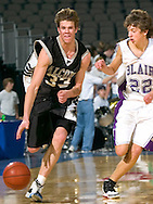 2/11/06 -- Omaha, Ne.Battle Creek Ida Grove's Casey Harriman drives the ball bast Blair's P.J. Mallette  at The Omaha Shootout, a High School Basketball tournament featuring some of the best prospects at the Qwest Center Omaha...(Photo by Chris Machian/Prarie Pixel Group).