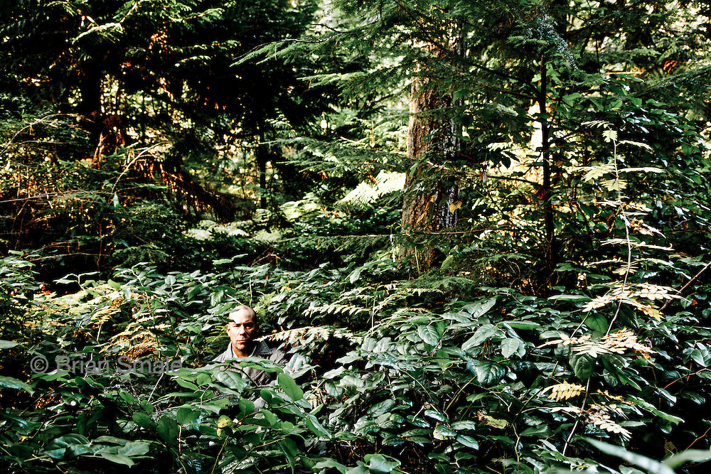 Bounty Hunter Mike Rocha, photographed in woods near his Everett WA home.