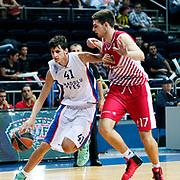 Anadolu Efes's Emircan Kosut ( L) during their Gloria Cup Basketball Tournament match Anadolu Efes between Crvena Zvezda at Ulker Sports Arena in istanbul Turkey on Friday 26 September 2014. Photo by Aykut AKICI/TURKPIX