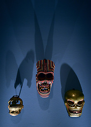 """© Licensed to London News Pictures. 14/11/2012. London, UK Three masks. Press preview of """"Death: A Self -Portrait. The Richard harris Collection"""" at The Welcome Collection today 14th November 2012. The exhibition showcases 300 works from a unique collection devote to the iconography of death and mankind's attitude towards it. Photo credit : Stephen Simpson/LNP"""