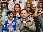 10 JANUARY 2015 - BANGKOK, THAILAND:  General PRAYUTH CHAN-OCHA, the Prime Minister of Thailand, on a television broadcast with teenagers during National Children's Day celebrations at Government House in Bangkok. National Children's Day falls on the second Saturday of the year. Thai government agencies sponsor child friendly events and the military usually opens army bases to children, who come to play on tanks and artillery pieces. This year Thai Prime Minister General Prayuth Chan-ocha, hosted several events at Government House, the Prime Minister's office.   PHOTO BY JACK KURTZ