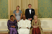 Princess Maxima and Prince Willem-Alexander and Queen Beatrix and President of Mali, Amadou Toumani Toure and Mrs. Toure Lobbo Traore, pose for the media before the statebanquet at palace Noordeinde in The Hague.