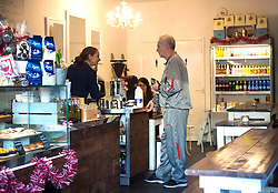 © Licensed to London News Pictures. 28/11/2015. London, UK. Labour Party leader JEREMY CORBYN buying coffee from his local coffee shop after leaving home in Islington, north London this morning (Sat). Jeremy Corbyn has come under pressure from his own party over a potential vote on UK military involvement in Syria. Photo credit: Ben Cawthra/LNP