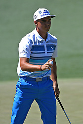 Rickie Fowler acknowledges the applause of the gallery after making a putt on the 2nd green during the third round of the Masters Tournament at Augusta National Golf Club in Augusta, Ga., on Saturday, April 8, 2017. (Photo by Jeff Siner/Charlotte Observer/TNS) *** Please Use Credit from Credit Field ***