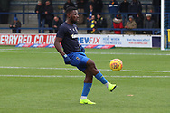 AFC Wimbledon defender Deji Oshilaja (4) warming up during the EFL Sky Bet League 1 match between AFC Wimbledon and Southend United at the Cherry Red Records Stadium, Kingston, England on 24 November 2018.