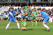 Lyle Taylor forward for AFC Wimbledon (33) tries to break through Hartlepool's defence during the Sky Bet League 2 match between Hartlepool United and AFC Wimbledon at Victoria Park, Hartlepool, England on 25 March 2016. Photo by Stuart Butcher.