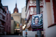 """A poster with the portrait of Mariella Franco who was murdered in Brazil used by a campaign against violence against woman. The empty city center called """"Römer"""" in Frankfurt am Main during a normally busy Thursday evening."""