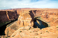 Photographer shooting Horseshoe Bend in Page Arizona.  Horseshoe Bend is a huge photogenic curve of the Colorado River
