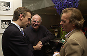 Anthony Lane, Martin Amis and Clive James. party for Anthony Lane's book hosted  given by David Remnick, editor of the New Yorker. River Cafe. 12 November 2002.  © Copyright Photograph by Dafydd Jones 66 Stockwell Park Rd. London SW9 0DA Tel 020 7733 0108 www.dafjones.com