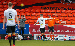 Partick Thistle's Tom Robson brought down by Dundee United's Paul Watson for their penalty. Dundee United 1 v 1 Partick Thistle, Scottish Championship game played 7/3/2020 at Dundee United's stadium Tannadice Park.