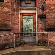 Idaho, Shoshone County, Wallace. 609 Bank St, an HDR image of a glass doorway against red brick in an alley