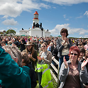 A very moved and happy audience after the final blow from the Souter fog horn. A REQUIEM FOR THE FOGHORN, PERFORMED BY SEVENTY FIVE BRASS PLAYERS, A FOGHORN AND AN ARMADA OF SHIPS<br /> A project by Danish artist, Lise Autogena, in collaboration with Joshua Portway and composer Orlando Gough. <br /> Ships horns from an armada of vessels off-shore, seventy five brass players on-shore and the Souter Lighthouse Foghorn  performed a Foghorn Requiem, an ambitious musical performance to mark the disappearance of the sound of the foghorn from the UK's coastal landscape.<br /> Conducted and controlled from a distance, ships at sea sounded their horns to a musical score, that will took into account landscape and the physical distance of sound. The performance took place by Souter Light House by South Shields, UK with thousands of spectators and more than 50 ships off-shore.