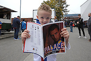 a Young Crystal Palace fan reads his match programme outside Selhurst Park before k/o. Barclays Premier League match, Crystal Palace v West Bromwich Albion at Selhurst Park in London on Saturday 3rd October 2015.<br /> pic by John Patrick Fletcher, Andrew Orchard sports photography.