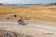 Joe Grabowski gravel bike riding from Polson to Hot Springs, Montana, USA climbing the Salish Range model released