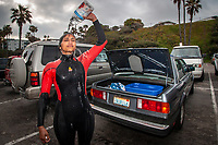 San Diego, California | 2007<br /> Lawyer, community organizer, and avid surfer, Roopal Shah douses herself with warm water after an early morning surf. She and her siblings founded Indicorps, an international not-for-profit organization that from 2001-2012 provided Indians in the diaspora with fellowships to participate in community development projects in India.
