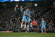The Celtic and Manchester City players jump to win a header from a Celtic corner during the Champions League match between Manchester City and Celtic at the Etihad Stadium, Manchester, England on 6 December 2016. Photo by Mark P Doherty.