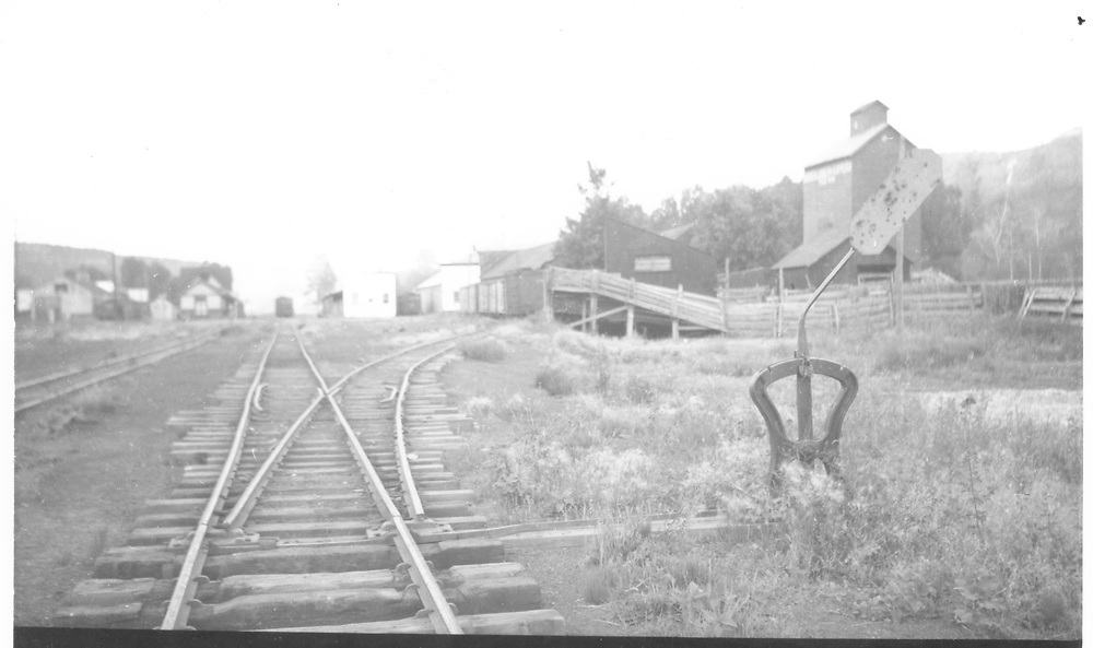 """View south in Dolores showing granary and RGS cattle stockade.<br /> RGS  Dolores, CO  Taken by Kelley, Frank O. - ? 8/27/1948<br /> In book """"Rio Grande Southern II, The: An Ultimate Pictorial Study"""" page 314<br /> This photo is horizontally flipped in Dorman's book.<br /> Also in """"RGS Story Vol. VIII"""", p. 43 where it is dated as 8/26/1948."""