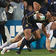 Mike Tindall, England, tackles Joe Ansbro, Scotland, during the England V Scotland Pool B match during the IRB Rugby World Cup tournament. Eden Park, Auckland, New Zealand, 1st October 2011. Photo Tim Clayton...