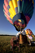 Hot air balloon being prepared for lift off.