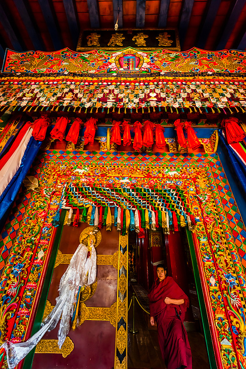 Buddhist monk, Songzanlin (Ganden Sumtsenling) Monastery, Shangri La, Yunnan Province, China. It is the largest Tibetan Buddhist monastery in Yunnan Province.