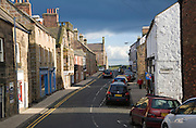 Light and shadow in the main village street at Alnmouth, Northumberland, England