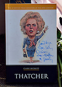 © Licensed to London News Pictures. 08/04/2013. London, UK A book signed by a well wishers. Flowers left at the house where former Conservative Prime Minister Margaret Thatcher lived in central London. Lady Thatcher dies this mooring from a suspected stroke. Photo credit : Stephen Simpson/LNP