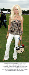 MISS HANNAH SANDLING at a polo match in Berkshire on 25th July 2004.PXL 347