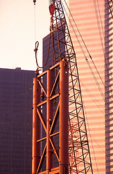 Stock photo of a heavy crane positioning a section of steel framework during original construction at the George R. Brown Convention Center in Houston, Texas.
