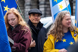 Pictured: Protestors were on hand to hear the judgement<br /><br />Judges delayed ruling on a legal bid aimed at forcing the Prime Minister to send a letter requesting a Brexit extension if no withdrawal deal is reached by October 19<br /><br />Ger Harley | EEm 21 October 2019