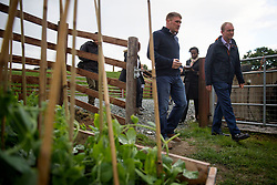 Liberal Democrats leader Tim Farron (right) during a visit to Pen Y Derw Farm in Forden while on the General Election campaign trail.
