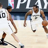 01 May 2017: San Antonio Spurs forward Kawhi Leonard (2) drives past Houston Rockets forward Trevor Ariza (1) on a screen set by San Antonio Spurs forward David Lee (10) during the Houston Rockets 126-99 victory over the San Antonio Spurs, in game 1 of the Western Conference Semi Finals, at the AT&T Center, San Antonio, Texas, USA.