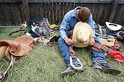 061910-Evergreen, COLORADO-saturdayprca-Cody Paterson takes a moment to prepare for the Saddle Bronc Riding competition at the 2010 Evergreen Rodeo Saturday, June 19, 2010 at the El Pinal Arena..Photo By Matthew Jonas/Evergreen Newspapers/Photo Editor
