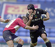 Reading, Berkshire, UK., 16th March 2002, Zurich Premiership Rugby, Madejski Stadium, England, [Mandatory Credit: Peter Spurrier/Intersport Images],<br /> <br /> Zurich Premiership-Madejski Stadium <br /> London Irish v Bristol<br /> Exile's No.8 Chris Sheasby, look's to push away David Rees tackle as he charges for the Bristol line.