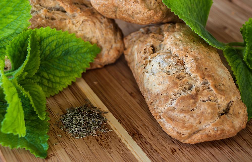 Herb Bread loaf with fresh oregano & dried thyme garnish