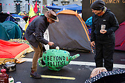 Morning breaks over Whitehall, climate change protesters camped outside start their day with a cup of tea  on 8th October, 2019 in London, Untited Kingdom. Extinction Rebellion plan to occupy 12 sites situated around key Government locations around Westminster for two weeks to protest against climate change.