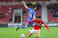 Middlesbrough forward Ashley Fletcher (18) goes down under pressure from Peterborough United defender Danny Lafferty (18) during The FA Cup 3rd round match between Middlesbrough and Peterborough United at the Riverside Stadium, Middlesbrough, England on 5 January 2019.
