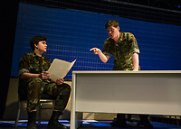 "Charles Purcell Capt. Matthew Markinson speaks with Ryan Witham Lt. Col. Nathan R. Jessup during dress rehearsal for ""A Few Good Men"" with Gilford High School on Monday afternoon.  (Karen Bobotas/for the Laconia Daily Sun)"