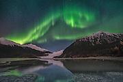 Enhanced photo of Northern Lights over Mendenhall Glacier. Southeast Alaska, Tongass National Forest.