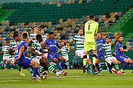António Adan saves in front of the opponents during the Liga NOS match between Sporting Lisbon and Belenenses SAD at Estadio Jose Alvalade, Lisbon, Portugal on 21 April 2021.