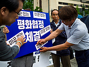 SEOUL, SOUTH KOREA: About 25 people gathered in front of the US Embassy in Seoul to express their concerns about the upcoming summit between US President Donald Trump and North Korean leader Kim Jong-un. The people said they represented a coalition of labor and progressive groups.      PHOTO BY JACK KURTZ