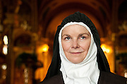 """Chicago resident Marcia Whitney-Schenck portrays several historical Catholics including Saint ThŽrse of Lisieux (1873-1897), pictured in costume at St. John Cantius Parish on Friday, August 9th. The French Saint became a Carmelite nun at the early age of 15, died of tuberculosis at 24 and was canonized in 1925 by Pope Pius XI. Nicknamed """" The Little Flower of Jesus"""", she is perhaps best known for The History of a Soul, her published diary. © 2013 Brian J. Morowczynski ViaPhotos<br /> <br /> For use in a single edition of Catholic New World Publications, Archdiocese of Chicago. Further use and/or distribution may be negotiated separately. <br /> <br /> Contact ViaPhotos at 708-602-0449 or email brian@viaphotos.com."""
