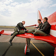 Pilots of the 'Red Arrows', aerobatic team, relax before a transit flight from RAF Valley, Wales after simulator day.