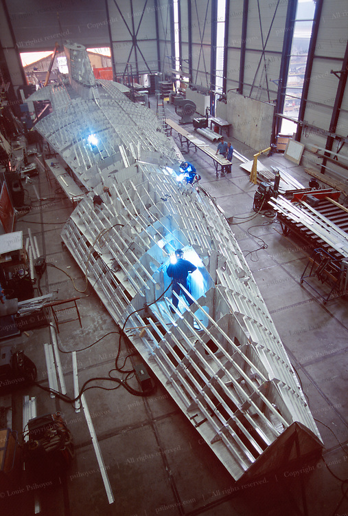 Fabricating Athena below the waterline occurs with the structure upside down for easy handling and welding.