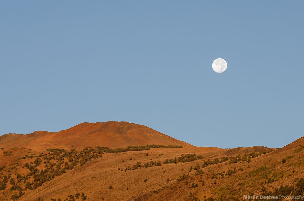 Full Moon above mountain ridge, Toiyabe National Forest, California