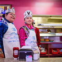 020715       Cable Hoover<br /> <br /> Rock Springs Veteran's Association princess Theophilia Begay-Charley and Ch'ooshgai princess Judith Duboise wait to greet customers during the Tip A Royalty fundraiser at Earl's Restaurant in Gallup Saturday.