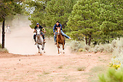 """09 SEPTEMBER 2007 -- ST. MICHAELS, AZ: Racers on the course of a two and a half mile long horse race at a traditional Navajo Horse Race in the summit area of the Navajo Indian reservation about 10 miles west of St. Michaels, AZ. Traditional horse racing is making a comeback on the Navajo reservation. The races are run on improvised courses that vary depending on the local terrain. Use of saddles is optional (except in the """"Cowhand Race"""" which requires a western style saddle) and many jockeys ride bareback. The distances vary from one mile to as long as thirty miles. Traditional horse races were common until the 1950's when they fell out of favor, but there has been a resurgence in traditional racing since the late 1990's and now there is a traditional horse racing circuit on the reservation. The race was organized by the Begay family of Steamboat, AZ and run on private land about three miles from a paved road.  Photo by Jack Kurtz"""